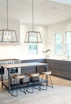 Shiplap walls and hood, modern cabinets on the bottom