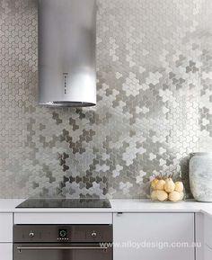 Karim Rashid for ALLOY 'Ubiquity' tile, brushed stainless steel mosaic tile. Kitchen design by Brendan Wong Design, stainless tube for exhaust fan .