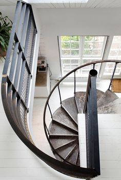 Who doesn't want a spiral staircase in their home, somewhere? It's so often seen in loft spaces, but I feel like it could be a great space-saving way to move between two levels in a more enclosed environment. I'm debating whether it would be a great way to get into my own basement.