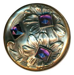 Large Repousee-style brass Art Nouveau daisies and purple glass jewels.