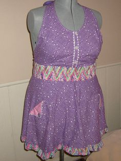 Hey, I found this really awesome Etsy listing at https://www.etsy.com/listing/102574346/purple-printed-party-apron-with-buttons