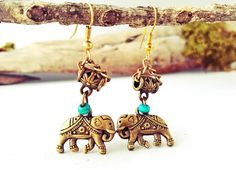 These gorgeous, traditional Thai style earrings use a sheeted silver elephant adorned with four red-orange wooden beads dangling from the feet. This are very unique item I created using the lessons of Thai Lanna hill tribe artistry I learned from a local elderly woman. If you're looking for stylish conversation piece, this is a great choice.