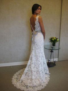 Backless lace wedding dress. I absolutely adore this!