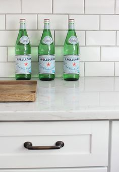 Cambria's Torquay quartz countertop (marble look-alike). White subway tile with light gray grout