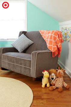 Fill your nursery with comfy, cozy touches for you and Baby, and you'll love the time you spend there all the more. The Eddie Bauer Chair-and-a-Half Rocker is extra wide, offering supportive arms and plenty of room for you, your little one, a comfy toss pillow and a few favorite plush toys. Add a colorful throw as a room-brightening accent, and a round braided rug for texture and warmth.