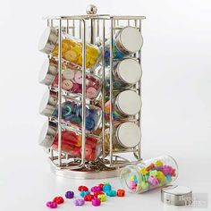 Recycle a spice rack into a storage tower for buttons, beads, glitter, and more. The clear jars make it easy to stay organized, and the swivel base makes everything accessible. This one is perfect for craft rooms on a budget!