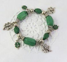 Green four leaf clover charm bracelet / charm by jewlerystar