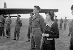 HRH Princess Elizabeth watching parachutists dropping during a visit to airborne forces in England in the run-up to D-Day.