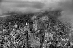 Very dark sky, the smell of rain fills the air & my mind immediately thinks of you co.  New York City Cloudy rainy day Empire State Building