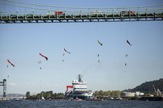 Activists hang under the St. Johns Bridge in Portland, Oregon, July 30, In an attempt to block the Shell leased icebreaker, MSV Fennica from passing under the bridge to join Shell's Arctic drilling fleet. Photo credit: Greenpeace USA