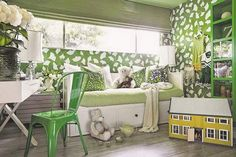 The bedroom of a tween cheerleader, designed by Brian Patrick Flynn, shows his use of the kelly green fabric of her cheerleading camp uniform as inspiration in Los Angeles. The green-covered space not only reminds her of cheerleading, but also wide open, green spaces.