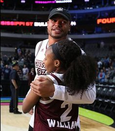 """Dak with """"Itty Bitty"""" at the final four tournament in Dallas."""
