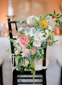 Floral Garland for Bride and Groom Chair Decor! See the wedding on SMP here: http://www.StyleMePretty.com/2014/06/03/timeless-austin-wedding-at-chateau-bellevue/  Photography: TaylorLord.com -- Floral Design: PetalPushers.us