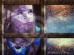 Girl at window in rain by Tamara Bauer, via Dreamstime