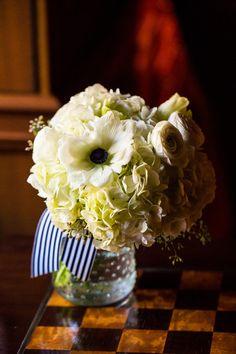 LOVE! Gorgeous floral arrangement... love the navy and white ribbon! @srvillage @lisamrhinehart