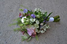 Rustic wedding bouquet using lilac flowers by Grace from Peamore Flora.