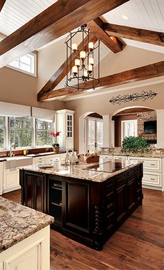 Large kitchen island with cooktop. See more in our kitchen cabinet gallery.