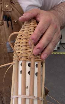 Making a wicker back quiver for arrows.                                                                                                                                                     More