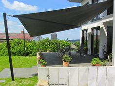 Sonnensegel elektrisch maritimo über Terrasse