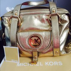 Michael Kors Lrg Metallic Gold Shoulder Bag Excellent condition, used ONCE (otherwise I would list as brand new) MK bag.  Medium to large size.  Comes with store bad, I have receipt as proof of purchase. I loved when I first bought but I'm saving for a Burberry bag I have my heart set on. Michael Kors Bags Shoulder Bags