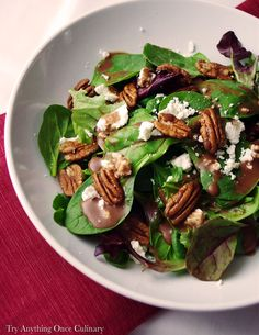 Cranberry Balsamic Vinaigrette | Greens, goat cheese and pecans drizzled with this cranberry sauce vinaigrette is sweet, tangy with a crisp finish.