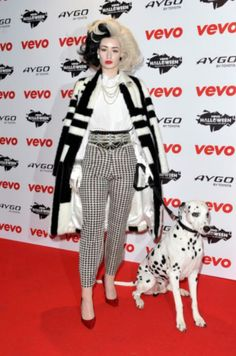 Iggy Azalea. Love her music. She's a great female rapper. She dressed up as Cruella DeVile Celebs went all out for HALLOWEEN (29 photos) NOVEMBER 1, 2013      http://theberry.com/2013/11/01/celebs-went-all-out-for-halloween/