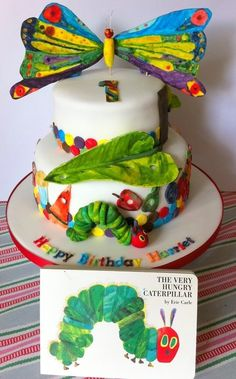"Perfect cake for kids! Made to go with ""The Very Hungry Caterpillar"" by Eric Carle. (is that a very hungry caterpillar cake? @Kat Libby)"
