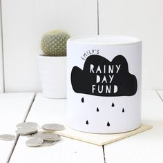 This simple yet quirky Rainy Day cloud fund Money box design by A Piece Of Limited. Simply choose your own personalised name to go above the cloud (see image), and present as a wonderful Christmas gift. Get your children planning their future adventures, and teach them how to save with these new personalised money boxes. Our money boxes will be despatched inside a sturdy cardboard box which will be perfect for wrapping as a gift. If you wish to have more money boxes made, or oif you have any alt...