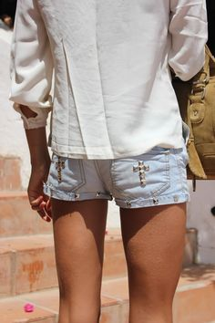 DIY shorts: studs on the fold are cute! Crosses not so much...