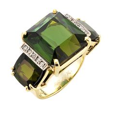 Brides.com: Green Engagement Rings. The Grass is Greener ring, 23.25 cts green tourmaline 0.10cts diamonds set in 9.20g of 14k yellow gold, $8,330, Graziela Gems  See more cushion-cut engagement rings.