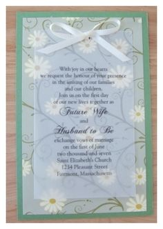 this same idea for invites... not so much daisy but the simplicity of the velum and ribbon