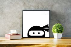 Cute stealthy ninja prints.  Great for kids rooms, playrooms, or anyone that likes fun black and white decor. https://www.etsy.com/listing/517219283/peering-ninja-print
