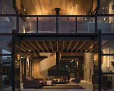 the ground floor living spaces opens onto the deck and welcomes the outdoors in