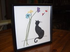 "Birthday gift for my lovely niece Kelcie!  I cross-stitch this using  the ""Garden Kitty"" pattern #2534 from Design Works Crafts, design by Marilyn Robertson.  I changed up some of the colors.  I mounted the finished picture in a black laquered  shadow box frame (from Hobby Lobby) to give the picture a little depth."