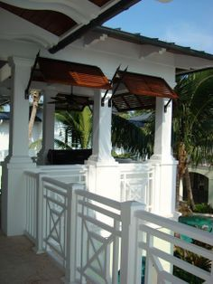 British Colonial Style Shutters In a Tropical Setting. - sandiego-shutters.com