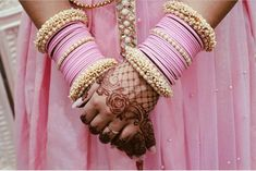 Pink Bridal Bangles With Pearls Bangles are often the perfect finishing touch to any Indian outfit. Pairing your favorite set with thick end bangles is a great way to bring your personal style to an otherwise simple set of bangles. Images by RJS & Co. Antique Jewellery Designs, Fancy Jewellery, Indian Jewellery Design, Stylish Jewelry, Bridal Bangles, Bridal Jewelry Sets, Bridal Accessories, Jewelry Accessories, Chuda Bangles