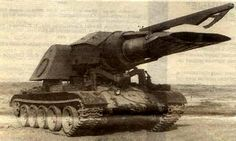 It's a Soviet Progvev-T, a gas-dynamic minesweeper. This 37-tons beast was a T-54 tank base and a MiG-15 jet engine on top. The trawler had also a container with kerosene that allowed to clear 6 kilometers of road without refueling. Apparently, this dragon used the MiG-15 engine to uncover and destroy mines with heat.