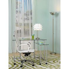 The glass top desk and zebra stripe rug set the tone for a contemporary office.