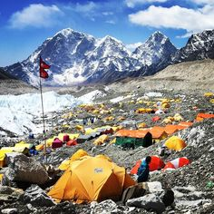 Tent city at Basecamp with the Khumbu Icefall spilling down the glacier on the left. #himalayas #basecamp #mountainlife #travel #neverstopexploring by ben__farmer__