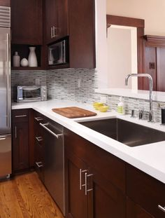 Love the cabinet and counter color combo // too modern for my taste with the hardware and sink. The colors (cabinets, floors, countertops, and backsplash) are what I like in this photo.