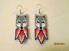 Items similar to Handmade Native Grey Wolf Brick stitch earring on Etsy Beaded Earrings Patterns, Bead Loom Patterns, Beading Patterns, Peyote Patterns, Stitch Patterns, Seed Bead Jewelry, Seed Bead Earrings, Animal Earrings, Beaded Jewelry