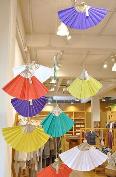 Hang colored fans, colorful display for New Yr, birthday, or wedding shower. Clothes Shop's Decoration in Tokyo, Japan http://www.babaghuri.jp/en/