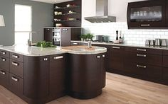 ikea cabinets | Rich dark brown IKEA kitchen cabinets in a modern-style kitchen. Photo ...