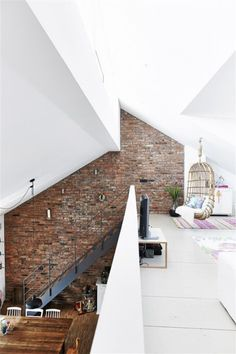 Gorgeous contrast between the red brick wall and white design elements in this modern loft. www.thegoodsheet.com.au