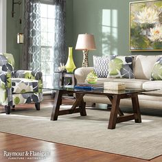 If you love nature-inspired colors like this, choose a serene sage green for your walls and add floral art. Then incorporate lime green decor and patterned curtains that call back to the prints on these accent pillows.