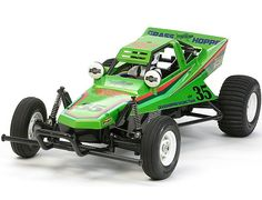 The Tamiya Grasshopper in Candy Green off-road RC buggy in 1/10th scale is back and more fun than ever before! The Grasshopper stands as one of Tamiya's most popular R/C cars ever released, helping launch a 2WD R/C buggy boom worldwide.  This Limited Edition version of the Grasshopper features a pre-coloured Candy Green Bodyshell.