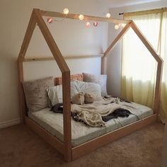 """Full size bed. 3"""" by 2.5"""" post make up the two ends - made by Corey K."""