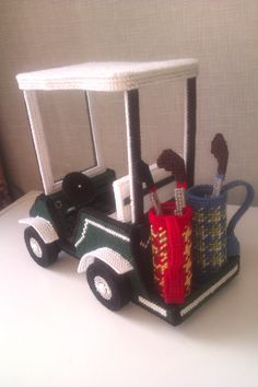 golf cart for barbie plastic canvas made by adrie ter wiel Reedijk from the Netherlands