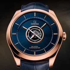 The central tourbillon cage offsets the effect of gravity, but there's no escaping the forces of attraction. (link in profile) #omega #omegawatches #watch #watches #deville #tourbillon #blue #gold #sednagold #watchmaking #horology #craftsmanship #watchesofinstagram #watchfam #watchoftheday #watchgeek​ #luxury