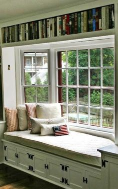 Bay window reading nook. I'm not a reader, but I would be if I had this.